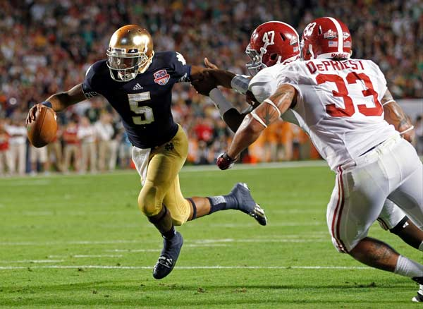 "<div class=""meta ""><span class=""caption-text "">Notre Dame quarterback Everett Golson (5) runs past Alabama's Xzavier Dickson (47) and Trey DePriest (33) for a touchdown during the second half of the BCS National Championship college football game Monday, Jan. 7, 2013, in Miami. (AP Photo/Wilfredo Lee)</span></div>"