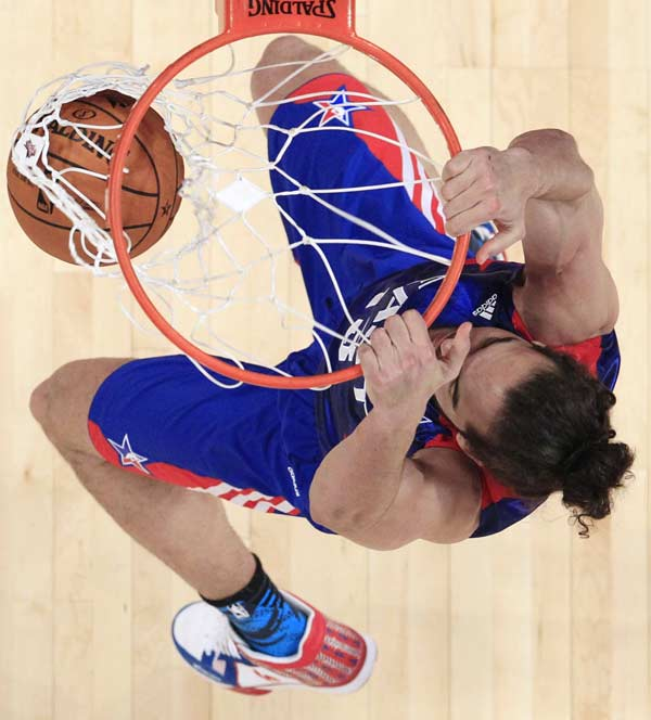 East Team's Joakim Noah from France, of the Chicago Bulls dunks, during the first half of the NBA All-Star basketball game Sunday, Feb. 17, 2013, in Houston. (AP Photo/Lucy Nicholson, Pool)