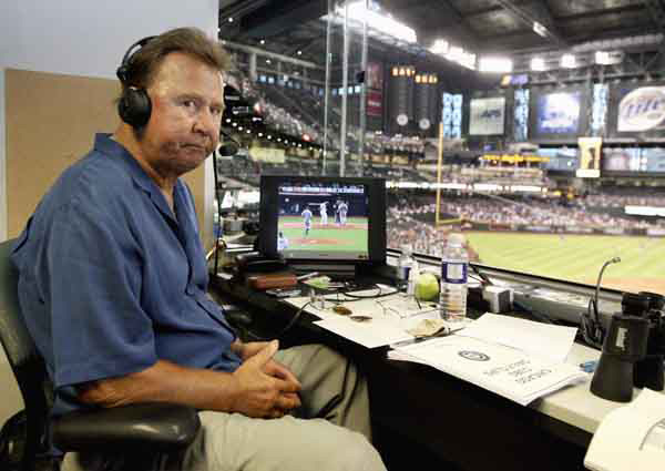 FILE - In this Oct. 4, 2007, file photo, former Chicago Cubs great and longtime radio announcer Ron Santo sits in the broadcast booth during a baseball game at Chase Field in Phoenix. Santo, who died Dec. 3, 2010, at the age of 70, was posthumously inducted into the National Baseball Hall of Fame and Museum on Sunday, July 22, 2012, along with Cincinnati Reds star shortstop Barry Larkin. (AP Photo/Rick Scuteri, File)