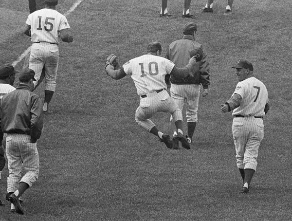 FILE - This June 24, 1969, file photo, shows Chicago Cubs third baseman Ron Santo (10) clicking his heels on the way to the locker room after his ninth-inning sacrifice fly allowed the winning run to score for a 5-4 victory over the Pittsburgh Pirates, in Chicago. Santo, who died Dec. 3, 2010, at the age of 70, was posthumously inducted into the National Baseball Hall of Fame and Museum on Sunday, July 22, 2012, along with Cincinnati Reds star shortstop Barry Larkin. (AP Photo/File)