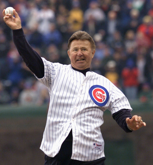 FILE - In this April 5, 2002, file photo, former Chicago Cubs third baseman Ron Santo throws out the ceremonial first pitch before the Cubs' home opener baseball game in Chicago. Santo, who died Dec. 3, 2010, at the age of 70, was posthumously inducted into the National Baseball Hall of Fame and Museum on Sunday, July 22, 2012, along with Cincinnati Reds star shortstop Barry Larkin. (AP Photo/Ted S. Warren, File)