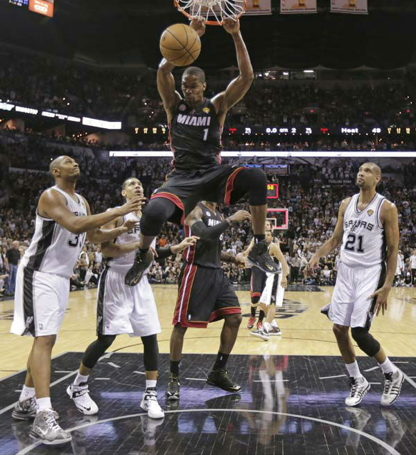 Miami Heat&#39;s Chris Bosh &#40;1&#41; dunks against the San Antonio Spurs during the first half at Game 4 of the NBA Finals basketball series, Thursday, June 13, 2013, in San Antonio.   <span class=meta>(AP Photo&#47;Eric Gay)</span>