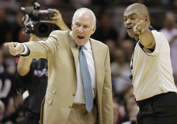 San Antonio Spurs&#39; Gregg Popovich and referee Tony Brothers &#40;25&#41; discuss action during the first half at Game 5 of the NBA Finals basketball series against the Miami Heat, Sunday, June 16, 2013, in San Antonio. <span class=meta>(AP Photo&#47;Eric Gay)</span>