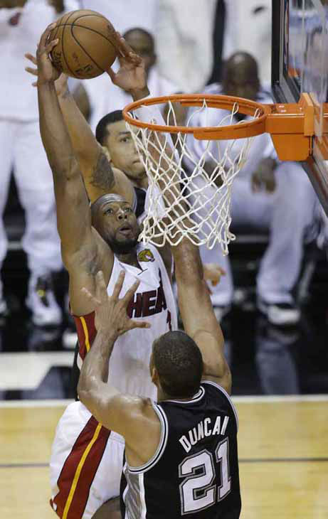 "<div class=""meta image-caption""><div class=""origin-logo origin-image ""><span></span></div><span class=""caption-text"">The Miami Heat's Dwyane Wade (3) shoots over San Antonio Spurs' Tim Duncan (21) during the second half in Game 7 of the NBA basketball championships, Thursday, June 20, 2013, in Miami.  (AP Photo/Wilfredo Lee)</span></div>"