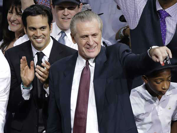 Miami Heat head coach Erik Spoelstra, left, and president Pat Riley celebrate after Game 7 of the NBA basketball championships, Friday, June 21, 2013, in Miami. The Miami Heat defeated the San Antonio Spurs 95-88 to win their second straight NBA championship.  <span class=meta>(AP Photo&#47;Wilfredo Lee)</span>