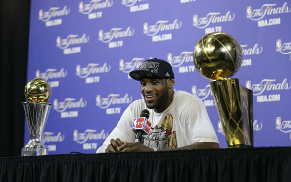 "<div class=""meta image-caption""><div class=""origin-logo origin-image ""><span></span></div><span class=""caption-text"">The Miami Heat's LeBron James smiles during a post game news conference following Game 7 of the NBA basketball championship game against the San Antonio Spurs, Friday, June 21, 2013, in Miami. The Miami Heat defeated the San Antonio Spurs 95-88 to win their second straight NBA championship.   (AP Photo/Lynne Sladky)</span></div>"