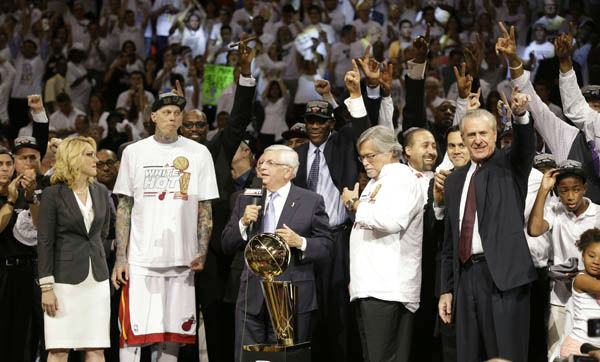 NBA Commissioner David Stern, speaks before presenting the Larry O&#39;Brien Championship Trophy to Miami Heat owner Micky Arison following Game 7 of the NBA basketball championships, Friday, June 21, 2013, in Miami. The Miami Heat defeated the San Antonio Spurs 95-88 to win their second straight NBA championship. To the right is Miami Heat president Pat Riley. <span class=meta>(AP Photo&#47;Lynne Sladky)</span>