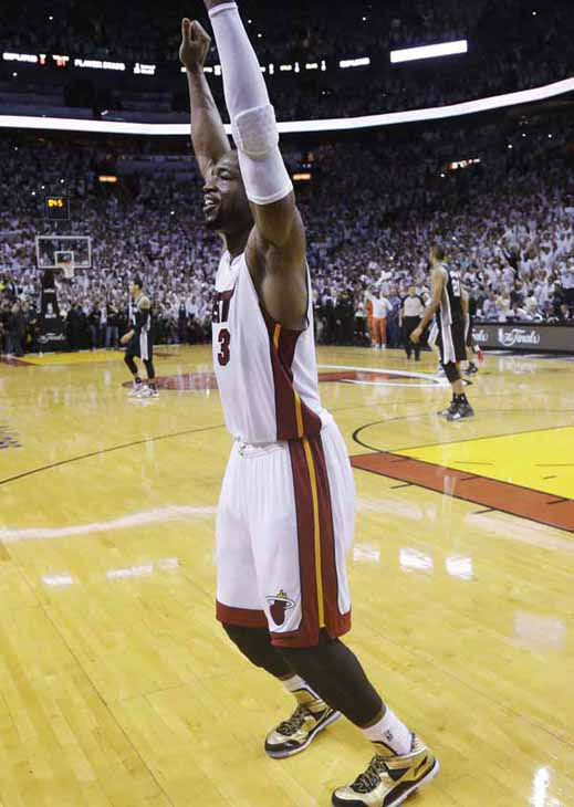 "<div class=""meta image-caption""><div class=""origin-logo origin-image ""><span></span></div><span class=""caption-text"">Miami Heat's Dwyane Wade (3) reacts at the end of Game 7 of the NBA basketball championships, Friday, June 21, 2013, in Miami. The Miami Heat defeated the San Antonio Spurs 95-88 to win their second straight NBA championship. (AP Photo/Lynne Sladky)</span></div>"