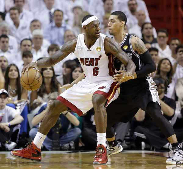 Miami Heat small forward LeBron James &#40;6&#41; and San Antonio Spurs shooting guard Danny Green &#40;4&#41; work during the first half of Game 1 of basketball&#39;s NBA Finals, Thursday, June 6, 2013 in Miami. <span class=meta>(AP Photo&#47;Lynne Sladky)</span>