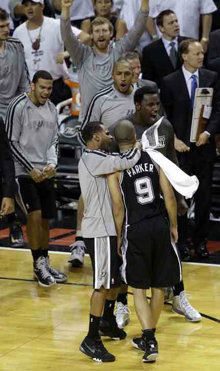 San Antonio Spurs teammates celebrate Tony Parker &#40;9&#41; during the second half of Game 1 of the NBA Finals basketball game against the Miami Heat, Thursday, June 6, 2013 in Miami. The Spurs defeated the Heat 92-88.  <span class=meta>(AP Photo&#47;Wilfredo Lee)</span>