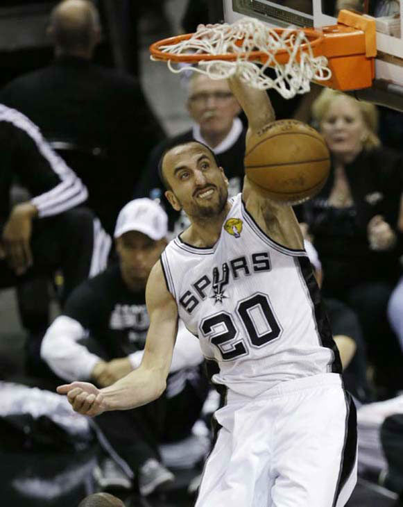 San Antonio Spurs&#39; Manu Ginobili &#40;20&#41;, of Argentina, dunks during the second half at Game 3 of the NBA Finals basketball series against the Miami Heat, Tuesday, June 11, 2013, in San Antonio. <span class=meta>(AP Photo&#47;David J. Phillip)</span>