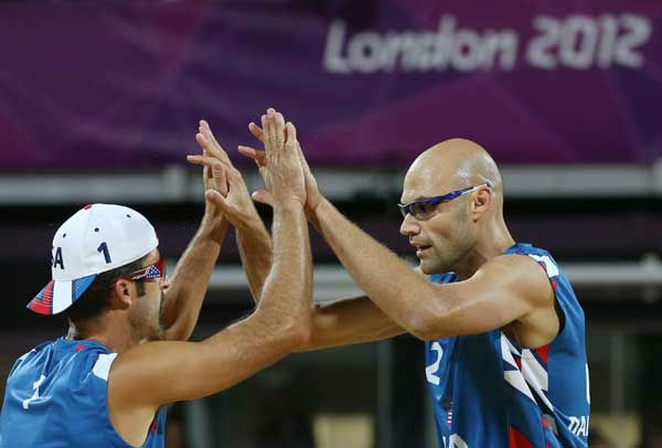 Phil Dalhausser, right, and Todd Rogers, left, of US celebrate after defeating Japan in their Beach Volleyball match at the 2012 Summer Olympics, Sunday, July 29, 2012, in London.  <span class=meta>(AP Photo&#47;Petr David Josek)</span>