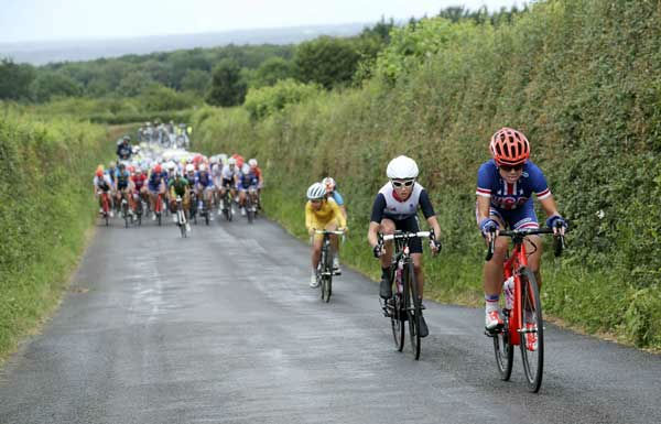 The United States&#39; Kristin Armstrong, right, leads the way during the women&#39;s cycling road race final at the 2012 Summer Olympics on Sunday, July 29, 2012, in London.  <span class=meta>(AP Photo&#47;Stefano Rellandini, Pool)</span>