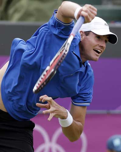 John Isner of the United States serves to Olivier Rochus of Belgium in a first round match at the All England Lawn Tennis Club in Wimbledon, London at the 2012 Summer Olympics, Saturday, July 28, 2012.  <span class=meta>(AP Photo&#47;Elise Amendola)</span>