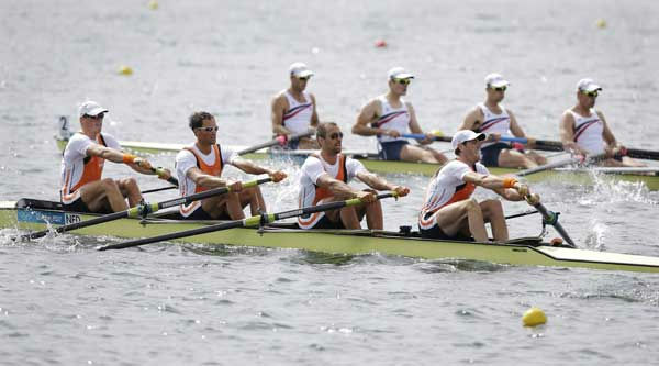 The Netherlands&#39; crew, bottom right to left, Mechiel Versluis, Ruben Knab, Kaj Hendriks and Boaz Meylink and U.S. rowers, top from right, Scott Gault, Charles Cole, Henrik Rummel and Glenn Ochal compete in a men&#39;s rowing four heat in Eton Dorney, near Windsor, England, at the 2012 Summer Olympics, Monday, July 30, 2012. The U.S. team won and Netherlands arrived second.  <span class=meta>(AP Photo&#47;Natacha Pisarenko)</span>