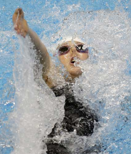 United States&#39; Missy Franklin competes in the women&#39;s 100-meter backstroke swimming heat at the Aquatics Centre in the Olympic Park during the 2012 Summer Olympics in London, Sunday, July 29, 2012.  <span class=meta>(AP Photo&#47;Lee Jin-man)</span>