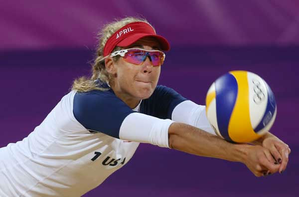 April Ross of US dives for a ball during the Beach Volleyball match against Argentina at the 2012 Summer Olympics, Sunday, July 29, 2012, in London.  <span class=meta>(AP Photo&#47;Petr David Josek)</span>