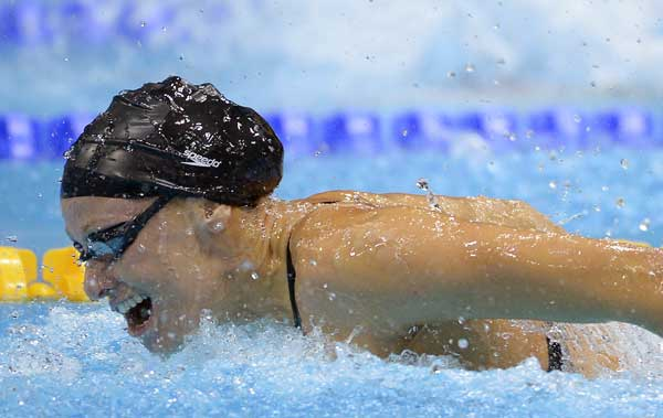 United States&#39; Dana Vollmer competes in the women&#39;s 100-meter butterfly swimming final at the Aquatics Centre in the Olympic Park during the 2012 Summer Olympics in London, Sunday, July 29, 2012. Vollmer set a new world record with a time of 55.98  <span class=meta>(AP Photo&#47;Mark J. Terrill)</span>