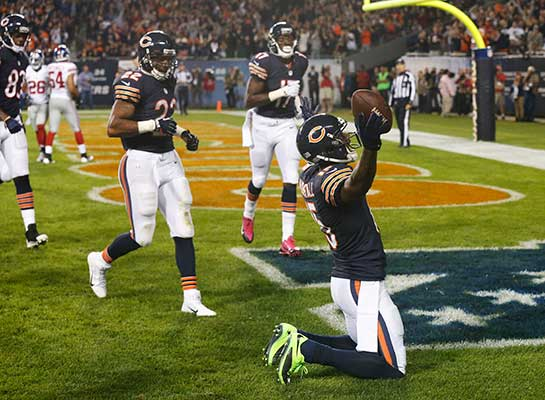 Chicago Bears wide receiver Brandon Marshall (15) celebrates his touchdown reception in the end zone in the first half of an NFL football game against the New York Giants, Thursday, Oct. 10, 2013, in Chicago. (AP Photo/Charles Rex Arbogast)
