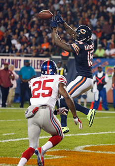 Chicago Bears wide receiver Brandon Marshall (15) makes a touchdown reception against New York Giants defensive back Will Hill (25) in the first half of an NFL football game, Thursday, Oct. 10, 2013, in Chicago. (AP Photo/Charles Rex Arbogast)