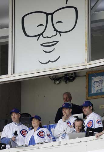 "<div class=""meta image-caption""><div class=""origin-logo origin-image ""><span></span></div><span class=""caption-text"">Tom Ricketts, standing second from right, owner of the Chicago Cubs, and family members prepare to sing ''Take Me Out to the Ball Game'' during the seventh inning stretch of the Cubs' baseball home opener against the Milwaukee Brewers at Wrigley Field on Monday, April 12, 2010, in Chicago. From left are Pete, Laura, Tom and Todd Ricketts. They purchased the Cubs in 2009.  (AP Photo/Charles Rex Arbogast)</span></div>"