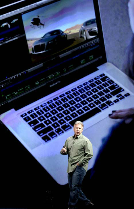 Phil Schiller, Apple&#39;s senior vice president of worldwide marketing, talks about new features to the company&#39;s laptops during the Apple Developers Conference in San Francisco,  Monday, June 11, 2012. Apple says it&#39;s introducing a laptop with a super-high resolution &#34;Retina&#34; display, setting a new standard for screen sharpness. &#40;AP Photo&#47;Marcio Jose Sanchez&#41; <span class=meta>(AP Photo&#47; Marcio Jose Sanchez)</span>