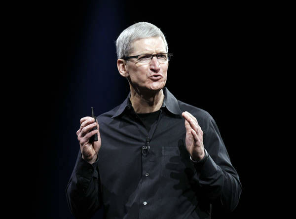 Apple CEO Tim Cook speaks at the Apple Developers Conference in San Francisco, Monday, June 11, 2012. Apple says it&#39;s introducing a laptop with a super-high resolution &#34;Retina&#34; display, setting a new standard for screen sharpness.The new MacBook Pro will have a 15-inch screen and four times the resolution of previous models, Cook told developers at a conference in San Francisco. &#40;AP Photo&#47;Paul Sakuma&#41; <span class=meta>(AP Photo&#47; Paul Sakuma)</span>