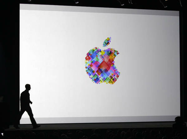 Apple CEO Tim Cook enters the stage during the Apple Developers Conference in San Francisco,  Monday, June 11, 2012. Apple says it&#39;s introducing a laptop with a super-high resolution &#34;Retina&#34; display, setting a new standard for screen sharpness. The new MacBook Pro will have a 15-inch screen and four times the resolution of previous models, Apple CEO Tim Cook told developers at a conference in San Francisco. &#40;AP Photo&#47;Marcio Jose Sanchez&#41; <span class=meta>(AP Photo&#47; Marcio Jose Sanchez)</span>