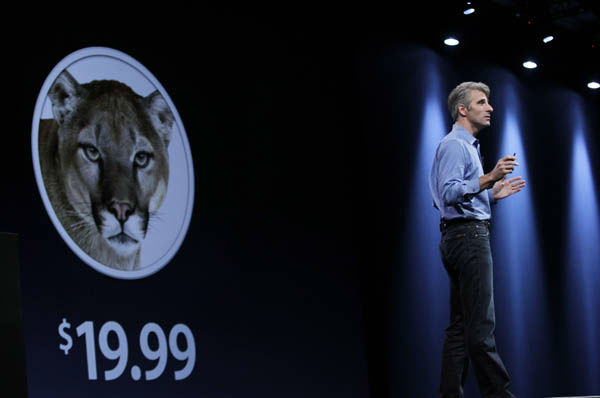 Apple&#39;s Craig Federighi talks about the new Mountain Lion for Macs at the Apple Developers Conference in San Francisco, Monday, June 11, 2012. The new Mountain Lion system narrows the gap between the PC and phone software packages, making Mac personal computers work more like iPhones.  &#40;AP Photo&#47;Paul Sakuma&#41; <span class=meta>(AP Photo&#47; Paul Sakuma)</span>