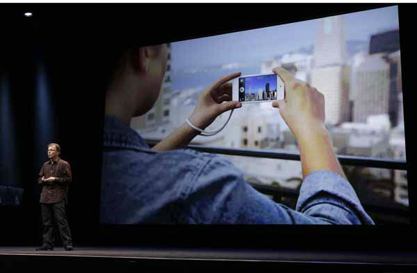 "<div class=""meta image-caption""><div class=""origin-logo origin-image ""><span></span></div><span class=""caption-text"">Greg Joswiak, Apple?s vice president of Hardware Product Marketing, talks the higher resolution new camera in the iPod touch about during the introduction of new products in San Francisco, Wednesday, Sept. 12, 2012.  (AP Photo/Eric Risberg) (AP Photo/ Eric Risberg)</span></div>"
