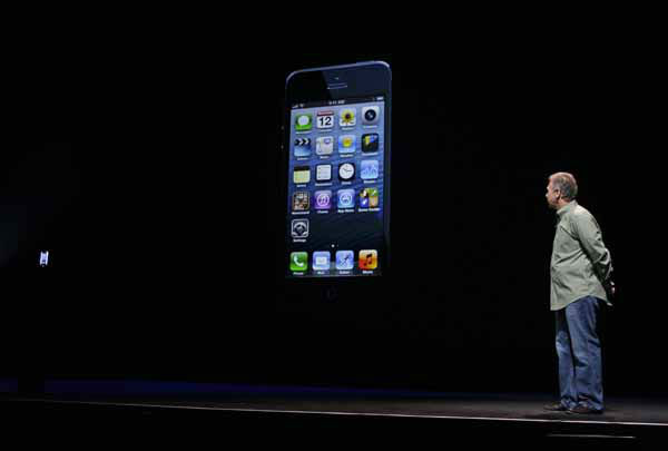 Phil Schiller, Apple&#39;s senior vice president of worldwide marketing, watches on stage the unveiling of the new iPhone 5 at an Apple event in San Francisco, Wednesday Sept. 12, 2012. &#40;AP Photo&#47;Eric Risberg&#41; <span class=meta>(AP Photo&#47; Eric Risberg)</span>