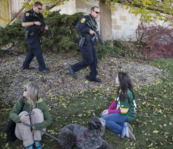 Police officers secure the area around Azana Salon after a shooting in Brookfield, Wis. Sunday, Oct. 21, 2012. Deputies searched Sunday for a shooter after multiple people were wounded when someone opened fire at a spa near a suburban Milwaukee shopping mall. (AP Photo/Tom Lynn)