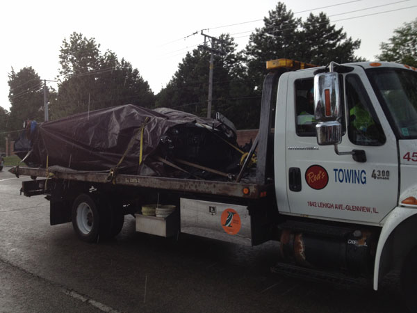 Photo of car being removed after being found in the wreckage of a freight train derailment on Thursday, July 5, 2012. (Photo by Ben Bradley)