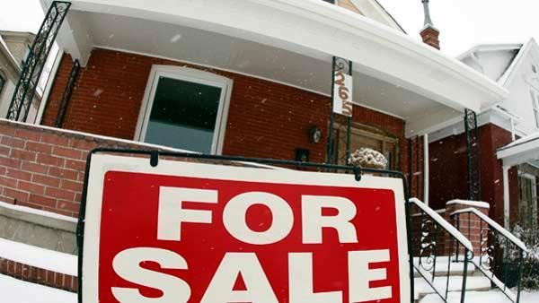 A sale sign stands outside a home on the market. (AP)