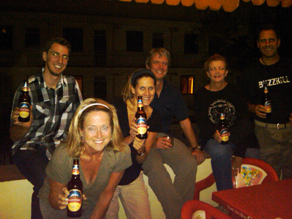 Our first Kilimanjaro beer with new friends after 20 hours of flying. <span class=meta>(Teri Goudie)</span>