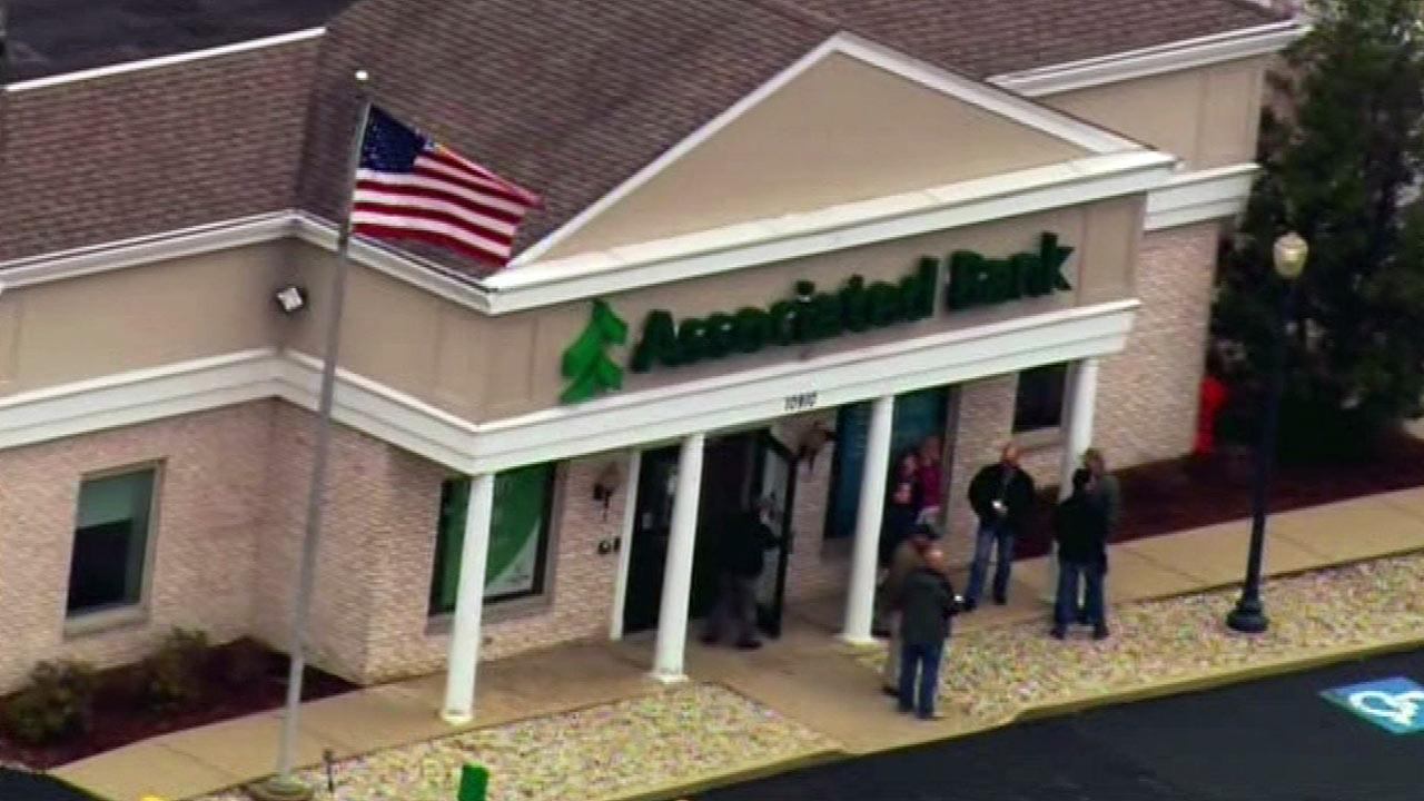 At least one person was shot and killed in the parking lot of a north suburban bank after an apparent robbery attempt.