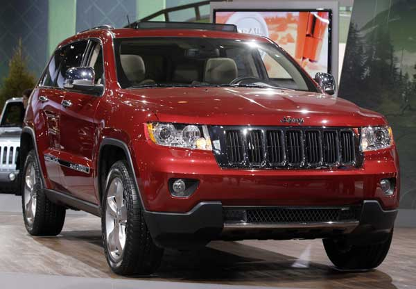Jeep introduces the Jeep Grand Cherokee during the media preview of the Chicago Auto Show at McCormick Place in Chicago on Wednesday, Feb. 8, 2012.  <span class=meta>(AP photo&#47;Nam Y. Huh)</span>