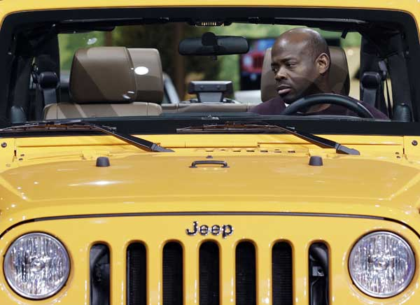 "<div class=""meta ""><span class=""caption-text "">A visitor looks around a Jeep Wrangler during the media preview of the Chicago Auto Show at McCormick Place in Chicago on Thursday, Feb. 9, 2012.  (AP photo/Nam Y. Huh)</span></div>"