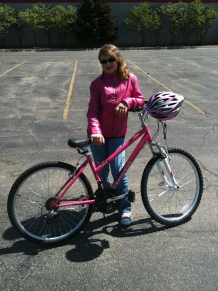 Emily, with her pink bike complete with pink leather jacket and pink helmet.