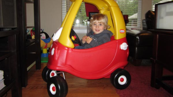 "<div class=""meta ""><span class=""caption-text "">""Our son Luca LOVES his coupe car!  He received it for Christmas and it is by far his favorite!  He's a complete ham and loves to beep the horn with his head for a good laugh and he will wave and yell ""Ciao, later gators!!"" when he is ""driving off""!""  </span></div>"