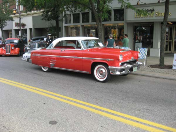 "<div class=""meta image-caption""><div class=""origin-logo origin-image ""><span></span></div><span class=""caption-text"">John James' 1954 Mercury Monterey two-door hardtop</span></div>"