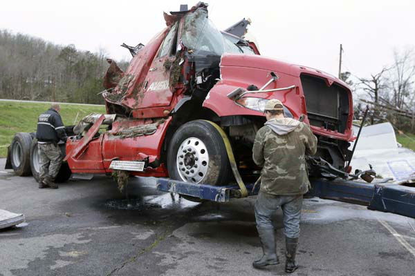 "<div class=""meta ""><span class=""caption-text "">Two men work to remove a truck in Botkinburg, Ark., Thursday, April 11, 2013, that was overturned when a severe storm struck the area late Wednesday. The National Weather Service is surveying areas Thursday to determine whether tornadoes or strong winds caused damage. (AP Photo/Danny Johnston) (AP Photo/ Danny Johnston)</span></div>"