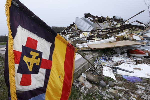 A flag flutters over what remains of the sanctuary of the Botkinburg Foursquare Church in Botkinburg, Ark., Thursday, April 11, 2013 after a severe storm struck the building late Wednesday. The National Weather Service is surveying areas Thursday to determine whether tornadoes or strong winds caused damage. &#40;AP Photo&#47;Danny Johnston&#41; <span class=meta>(AP Photo&#47; Danny Johnston)</span>