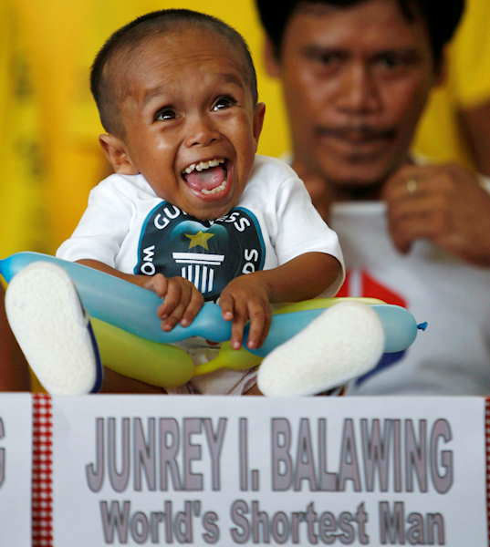 "<div class=""meta ""><span class=""caption-text "">Junrey Balawing reacts after he was officially declared ""the world's shortest living man"" by the Guinness World Records at Sindangan Municipal Hall in Sindangan township, Zamboanga Del Norte province in Southern Philippines, Sunday June 12, 2011, on his 18th birthday and coincidentally the Philippines' Independence Day. Balawing was officially declared ""the world's shortest living man"" with a measurement of 23.5 inches (59.93 centimeters) dislodging Nepal's Khagendra Thapa Magar with a measurement of 26.4 inches (67 centimeters).  (Photo/AP)</span></div>"
