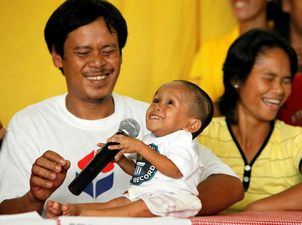 Reynaldo, left, and Concepcion Balawing, parents of Junrey Balawing, center, 18, react as Junrey jokes on the microphone after he was officially declared &#39;the world&#39;s shortest living man&#39; by the Guinness World Records at Sindangan Municipal Hall, Sindangan township, Zamboanga Del Norte province in Southern Philippines, Sunday June 12, 2011. Balawing was officially declared &#39;the world&#39;s shortest living man&#39; with a measurement of 59.93 Centimeters &#40;23.5 inches&#41; dislodging Nepal&#39;s Khagendra Thapa Magar with a measurement of 26.4 inches.  <span class=meta>(Photo&#47;AP)</span>