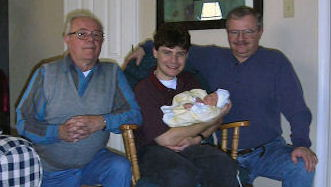 6at4.com producer Corey Herman holding his son Parker in 1999, along with grandfather John Herman, Sr. (left) and father John Herman, Jr. in 1999.