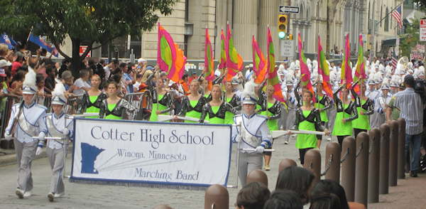 The Cotter High School Marching Band from Minnesota performed under the direction of Dave Gudmastad. The 97 members of the school's summer marching band represent nearly 35% of the student body, and is recognized as one of the outsdanding band programs in Minnesota. Cotter High School is marking its centennial this year.