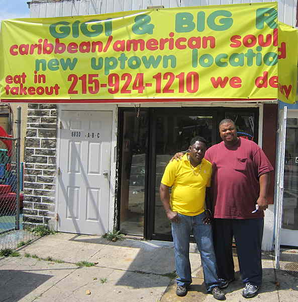 Big R. (left) and Gigi (right) pose outside one of their two restaurants serving up a fusion of Caribbean and Heartland recipes.
