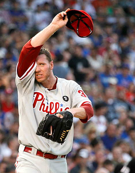 Philadelphia Phillies starting pitcher Roy Halladay wipes the sweat from his face during the third inning of a baseball game against the Chicago Cubs Monday, July 18, 2011 in Chicago. Halladay eventually left the game because of the severe heat, but said the next day that he should make his next scheduled start for the Phillies. <span class=meta>(&#40;AP Photo&#47;Charles Rex Arbogast&#41;)</span>