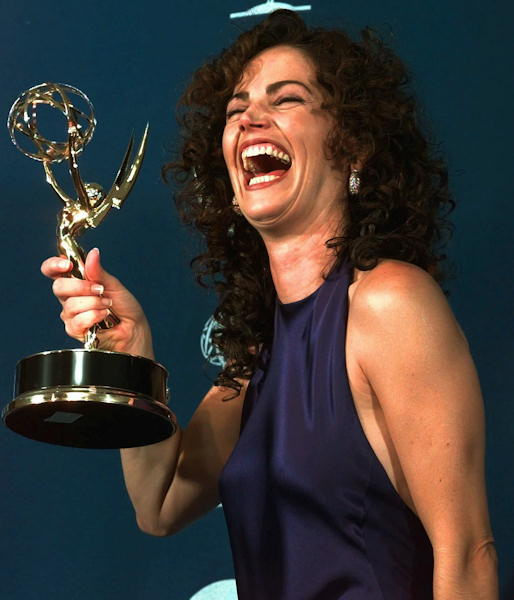 Actress Kim Delaney laughs, holding her award for outstanding supporting actress in a drama series for &#34;NYPD Blue&#34; at the 49th Annual Primetime Emmy Awards, Sunday Sept. 14, 1997 in Pasadena, Calif.  <span class=meta>(AP Photo&#47;Michael Caulfield)</span>